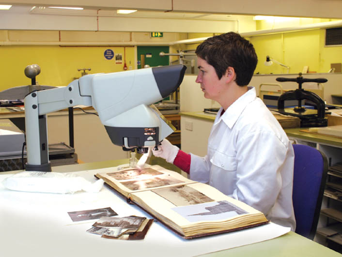 Image of a curator working with the photographic collections