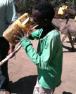 Boy Drinking Dirty Water
