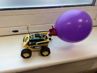 hackbot robot with balloon attached