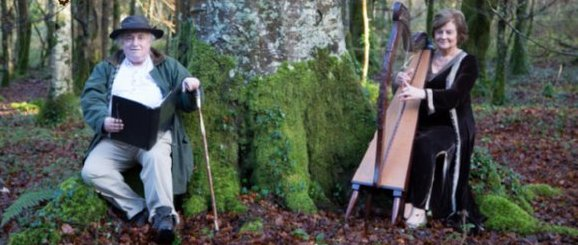 Woodland Bard with Claire Roche on harp in the forest