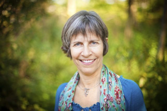 Portrait of Kim Wallant, art therapist, play therapist, founder of True North Creative Therapy