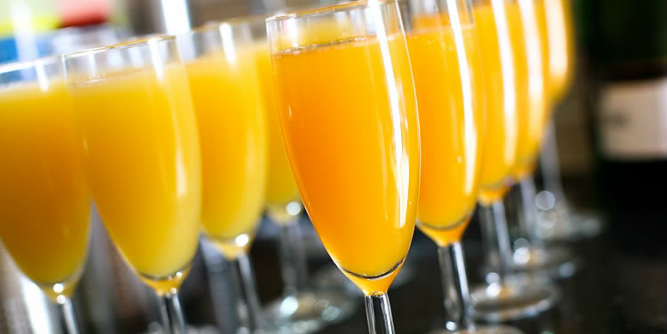 Picture - Row of mimosas in champagne flutes