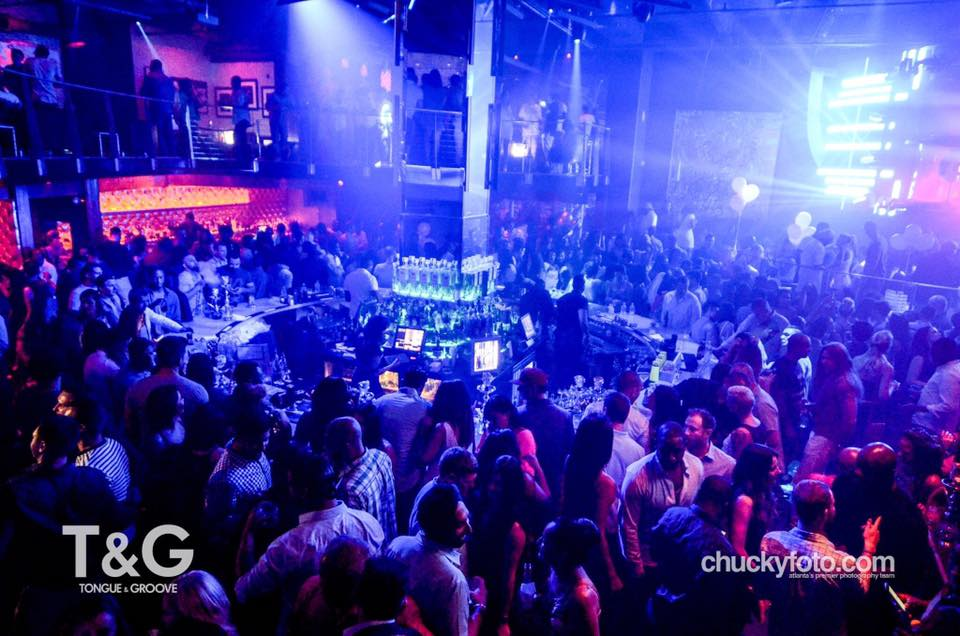 Busy dance floor and round bar at Tongue & Groove Atlanta