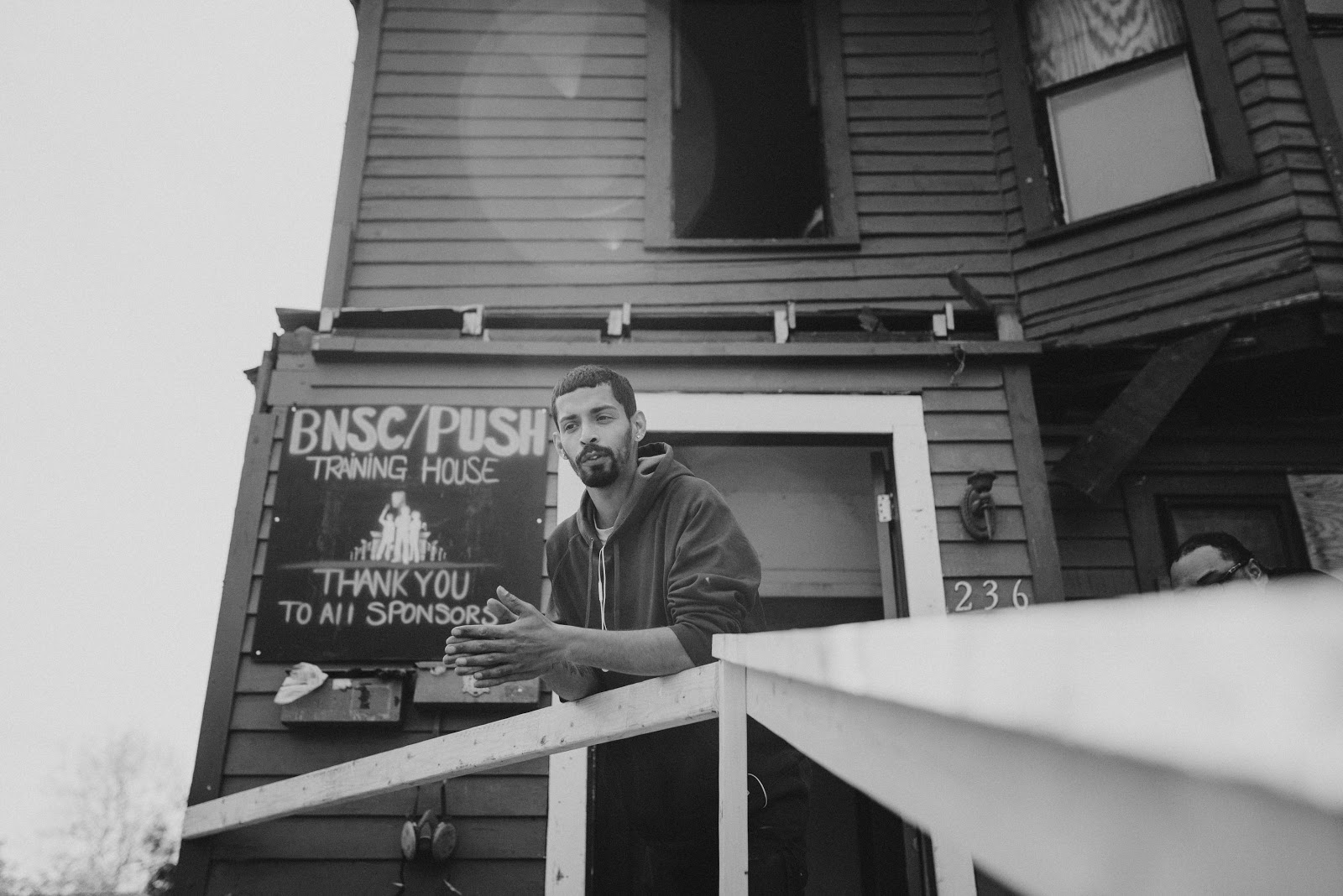 Image shows a person standing in from of the BNSC/PUSH Buffalo office