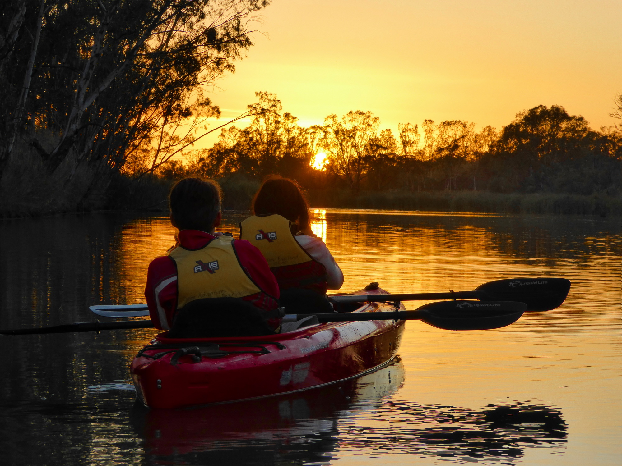 Kayakers enjoying a beautiful sunset.