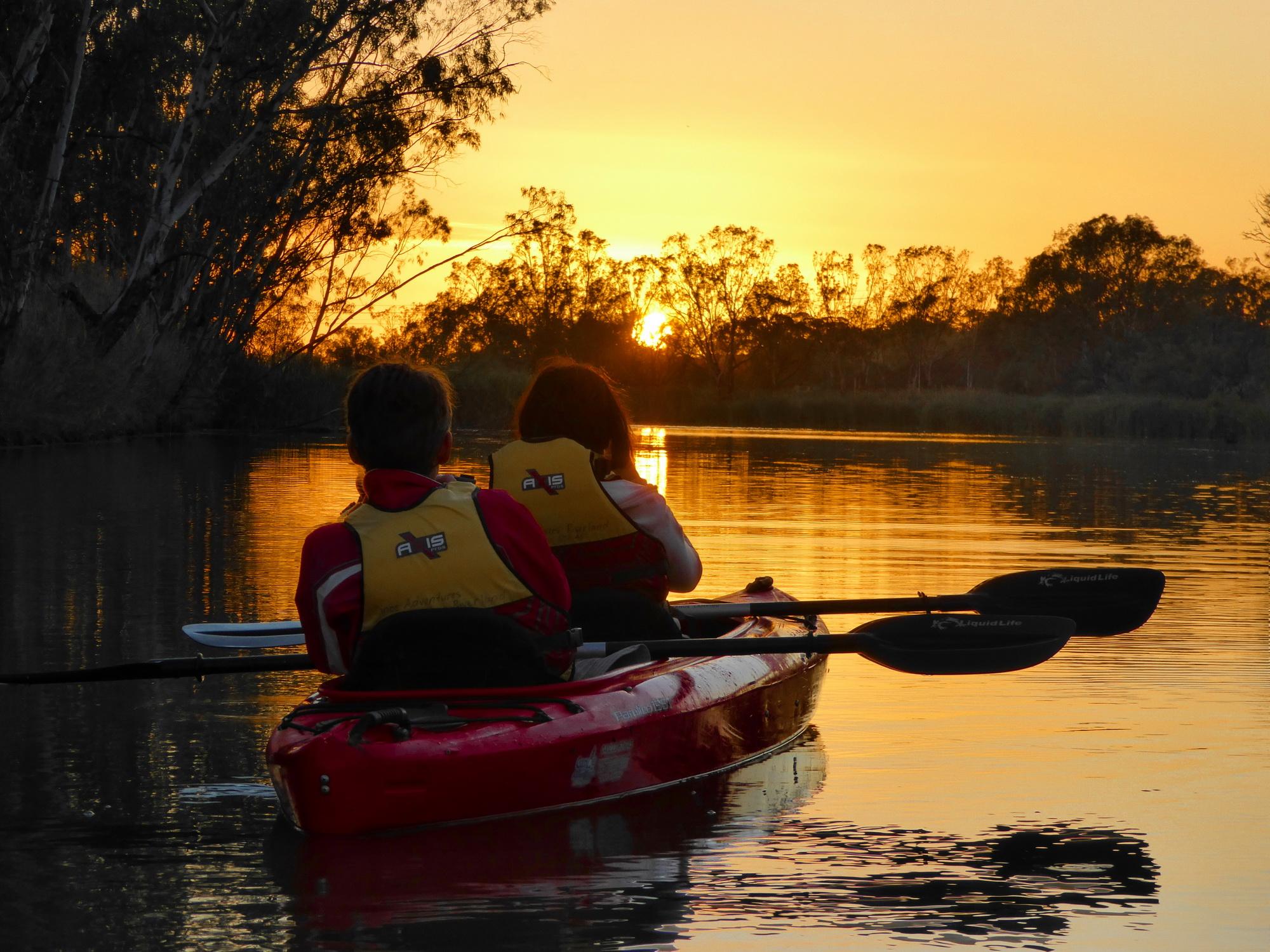 Kayakers enjoying a beautiful sunset.