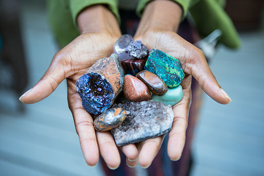 Hands holding earth healing stones