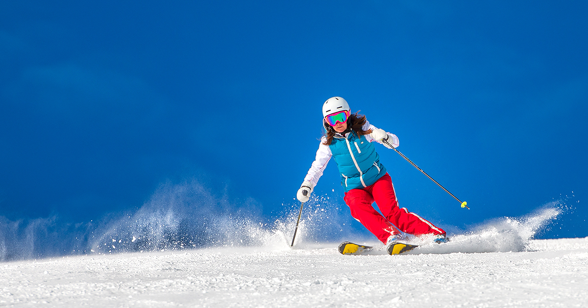 Woman Alpine Skiing under clear skies