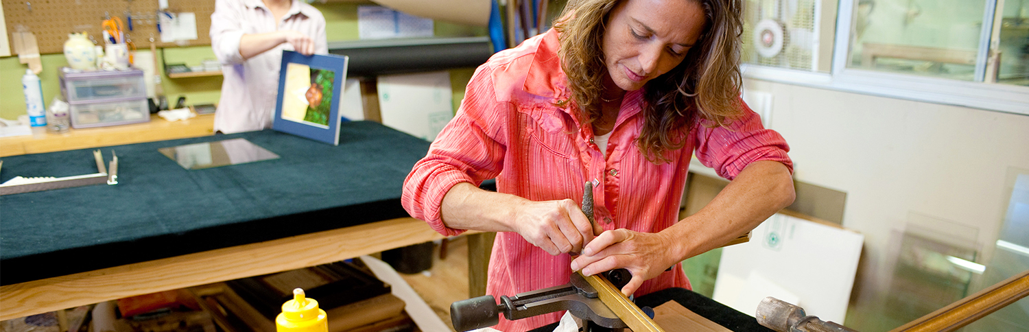 Woman handcrafting a picture frame