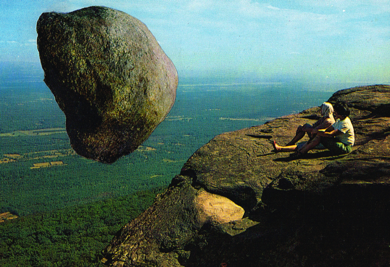 collage on a vintage postcard showing two people gazing at a huge boulder floating mid-air