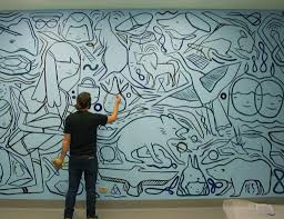 Man drawing on wall