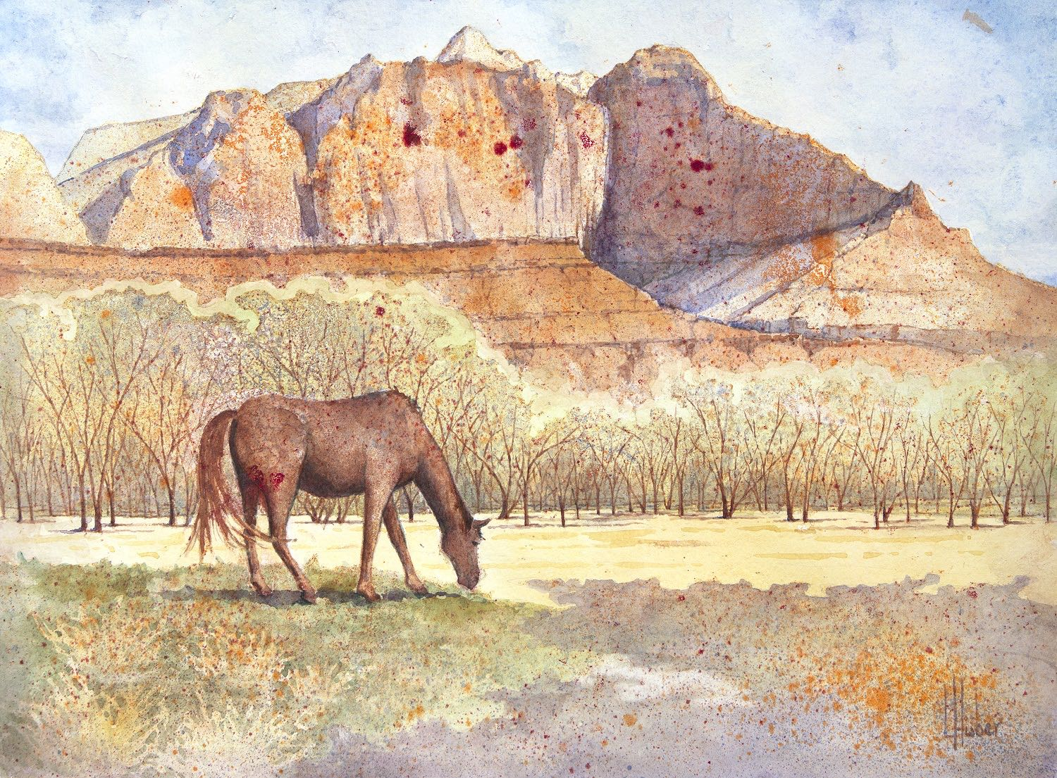 Horse in field with mountain behind