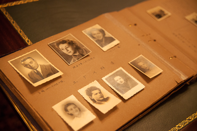 An old photo album with monochrome portraits