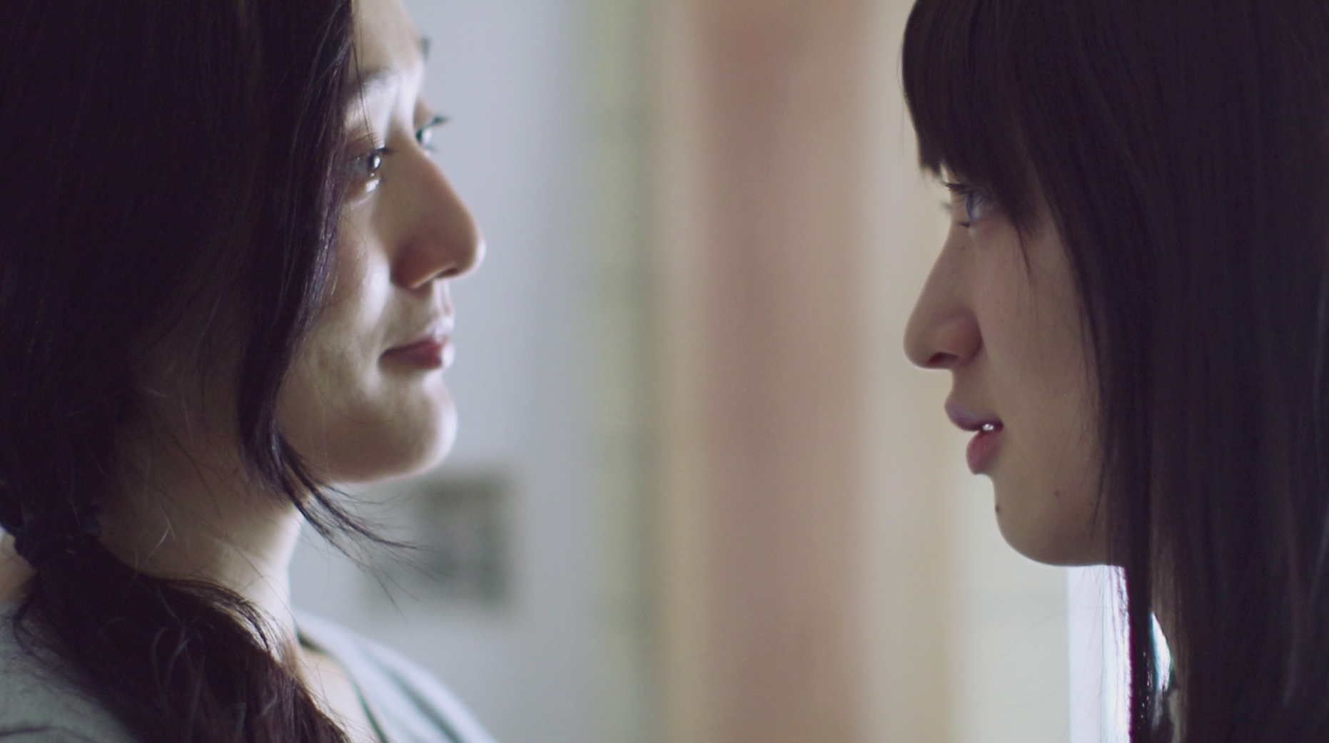 Two women talking with each other