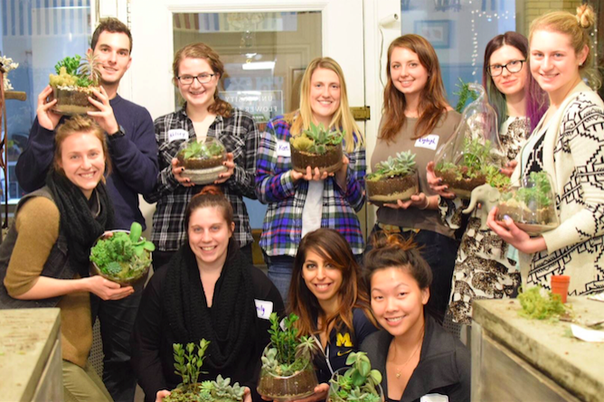 Image of group holding terrariums they designed