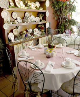 A serene scene of the Tea Rose Garden's china and table presentation in their garden-like motif.
