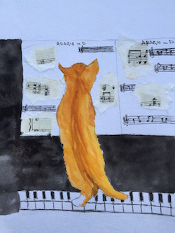 Ginger cat playing piano
