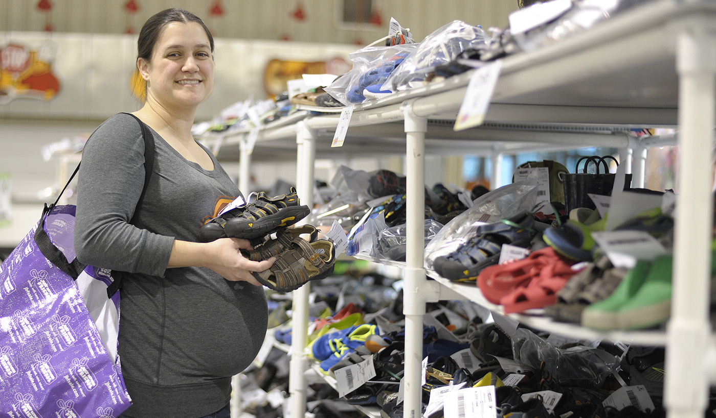 Pregnant new parent shopping the Just Between Friend Sale
