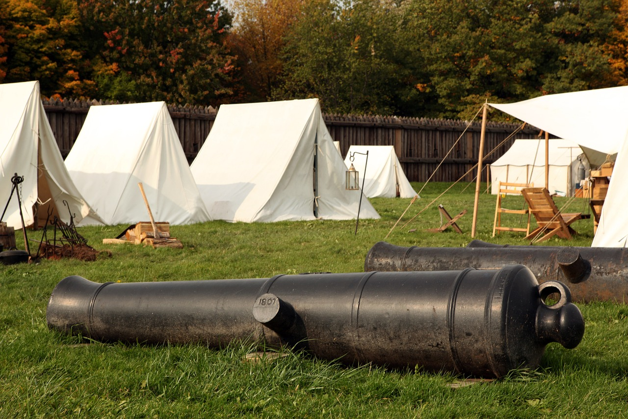A living history reenactment camp with rows of tents