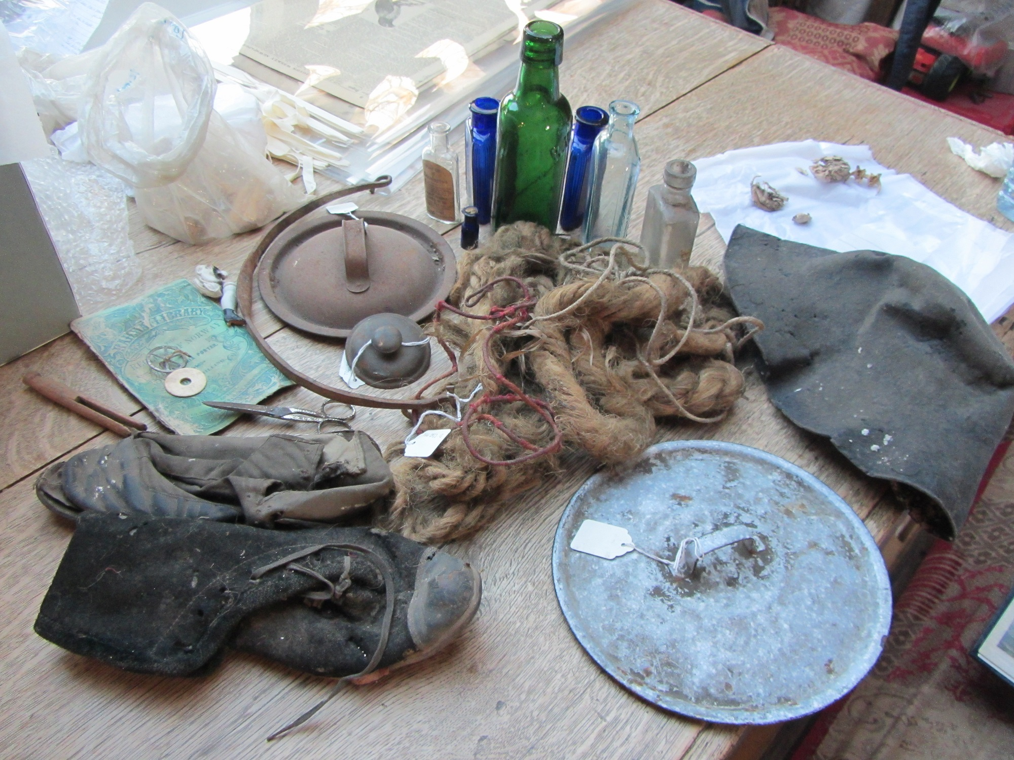 Concealed Revealed objects including hair, a shoe and documents