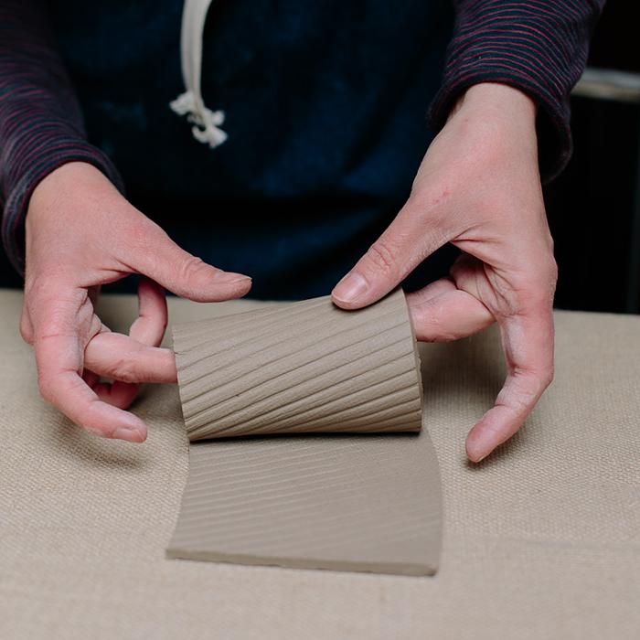 Slab-building, assembling a cylinder