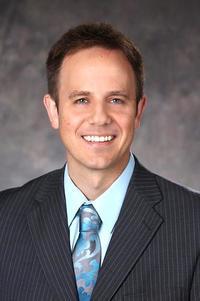 headshot of Greg Barthelette with gray backdrop