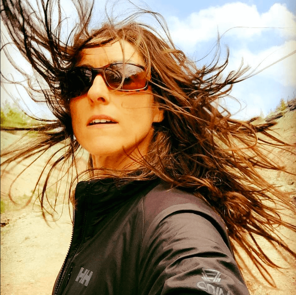 Sarah Thomas Moffat headshot long hair flying in wind