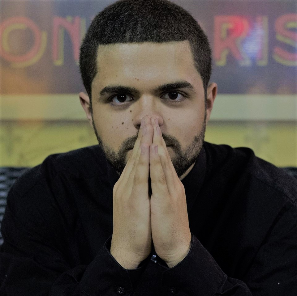 Hanz Rivero prays