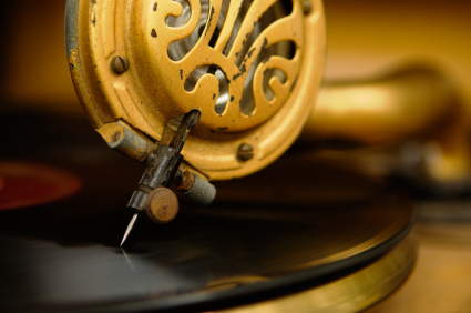 Antique turntable playing a 78 RPM record.