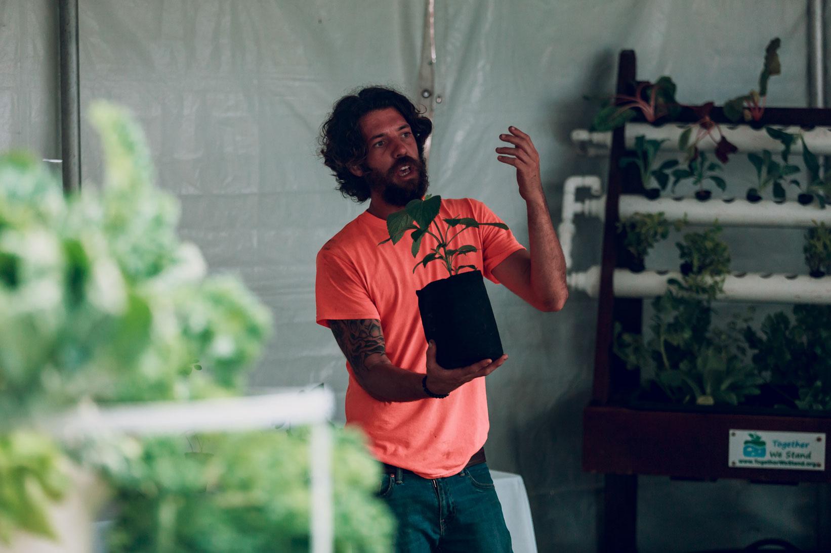 Gardener teaching a class
