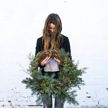 Jenevieve holding a wreath