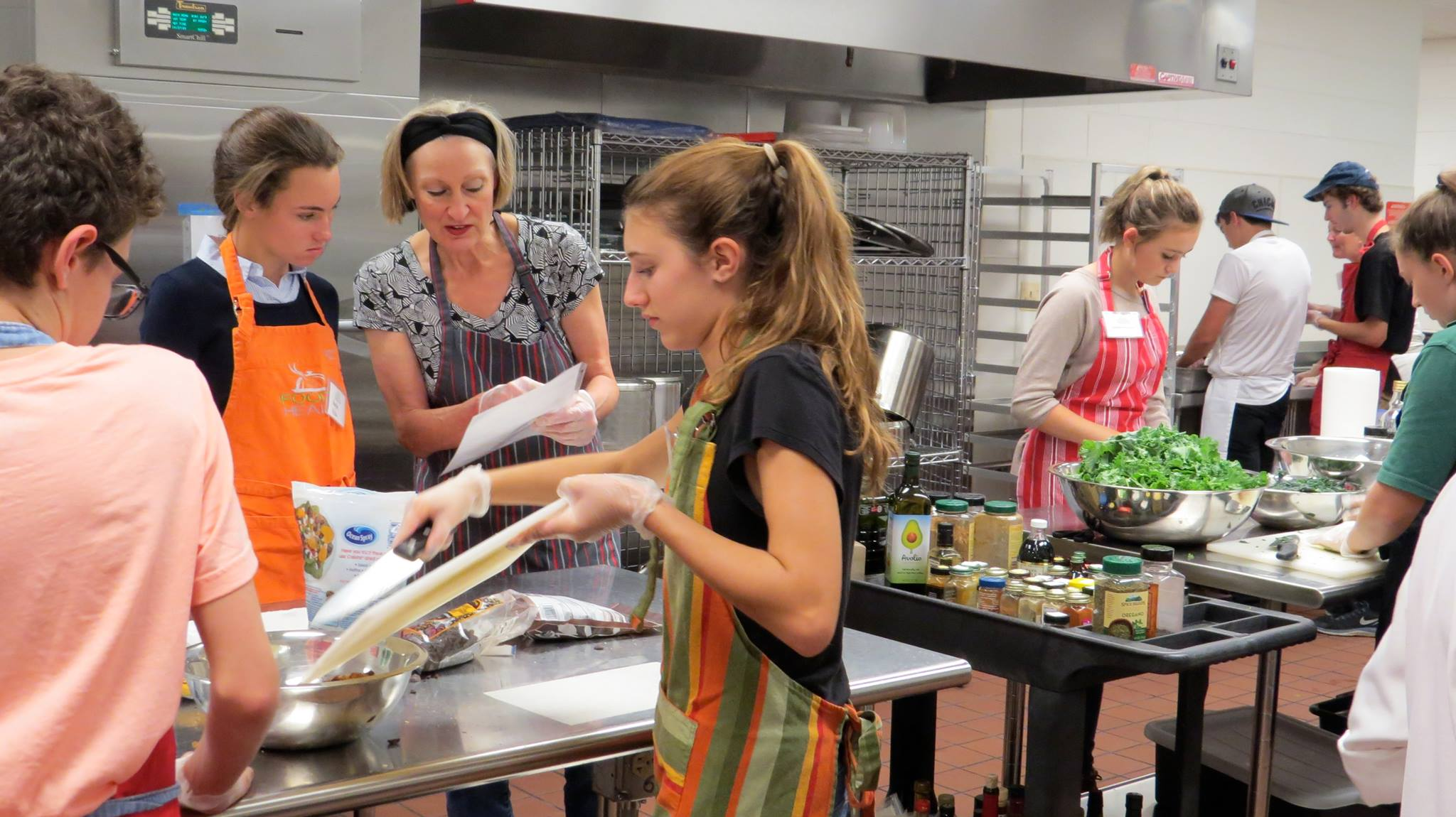 Teen volunteers working in the kitchen at Fox Valley Food for Health.