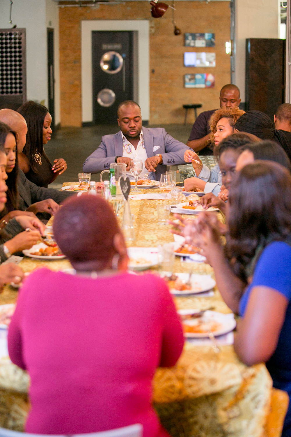 Happy guests feasting at Tokunbo's Kitchen