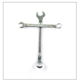 Two wrenches arranged in the shape of a crucifix