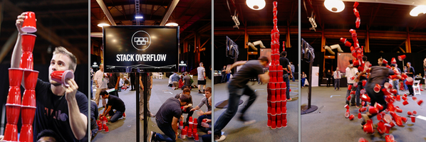 Hacker Olympics San Francisco attendees try to build the tallest possible tower of plastic cups.