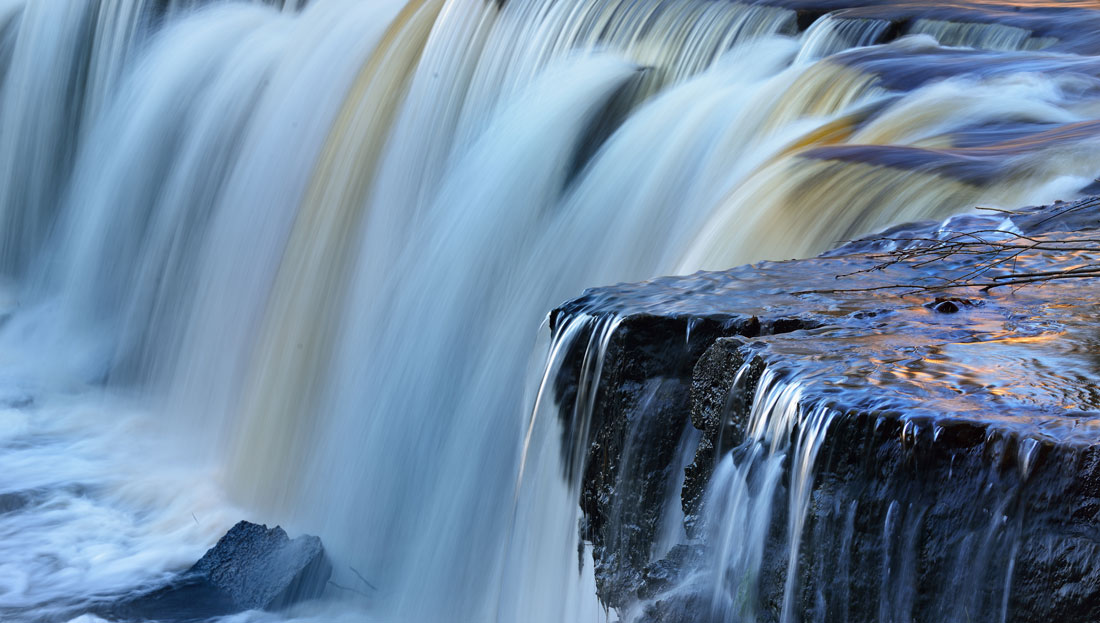 Meditation and Darshan - Flowing waterfall and rocks