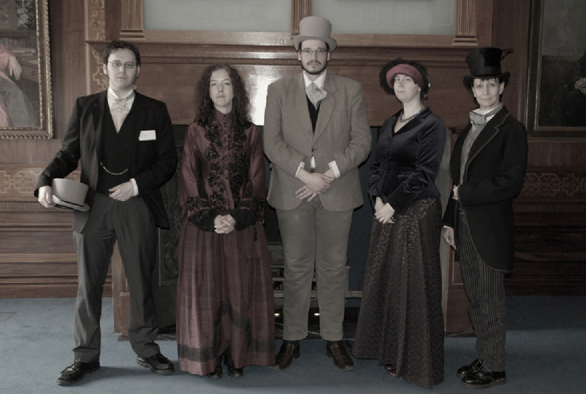 5 men and women in Victorian dress