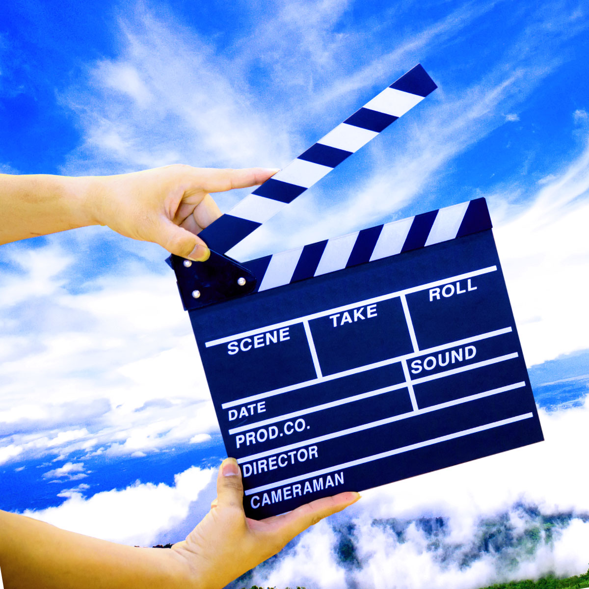 Movie slate in front of a blue sky