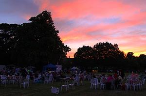 The sun sets across the Busk Till Dusk festival
