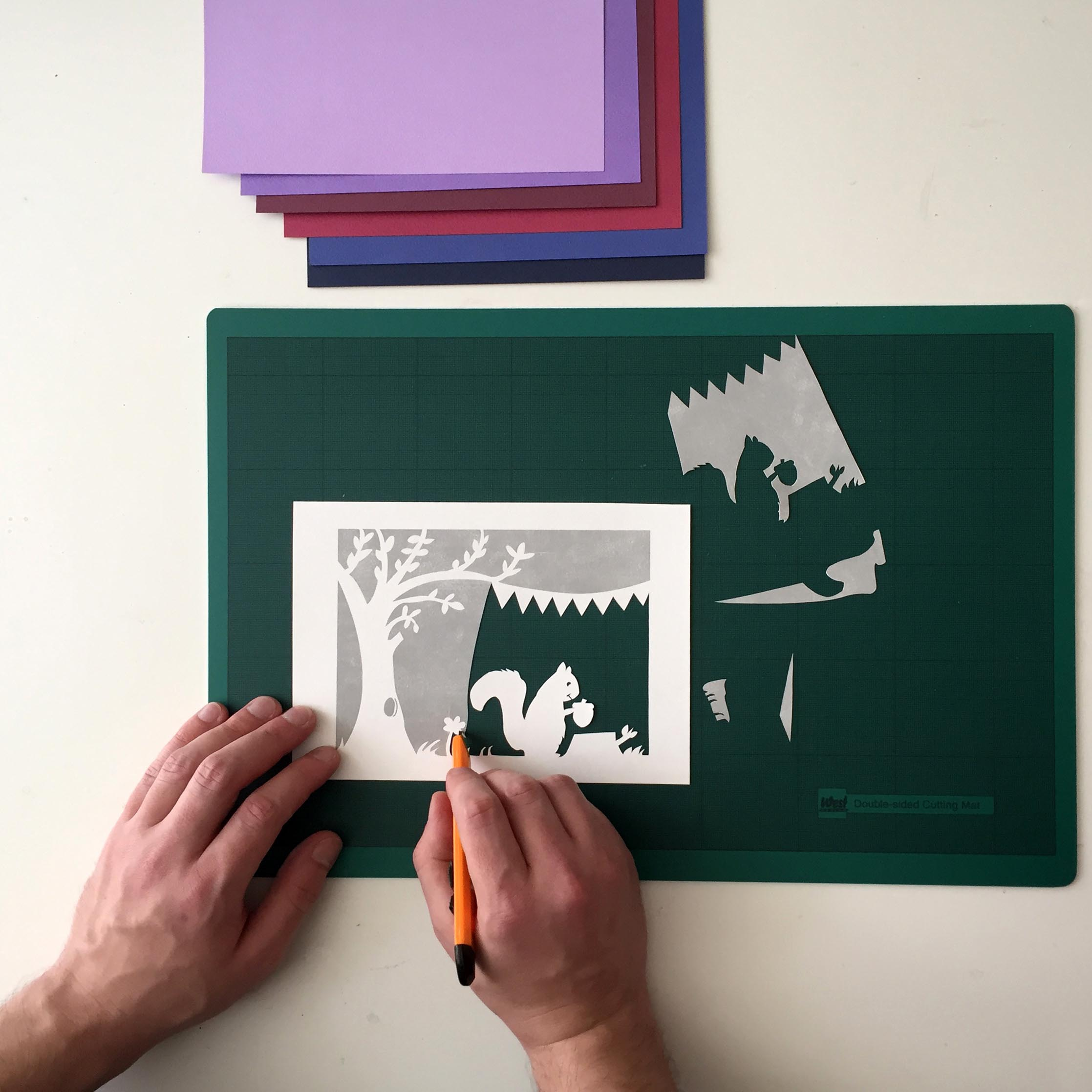 paper cutting workshop showing cutting in progress on a practice sheet