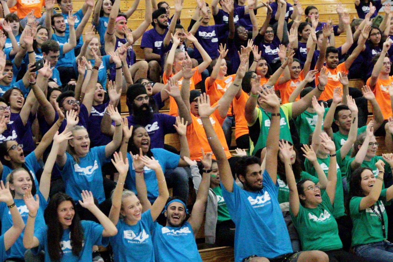 Students in colourful EDGE shirts are raising their hands