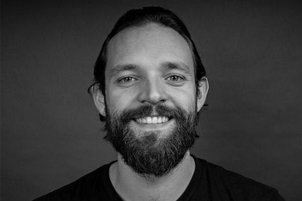 Black & white portrait of Daniel Staines, Creative Director at Algorithm