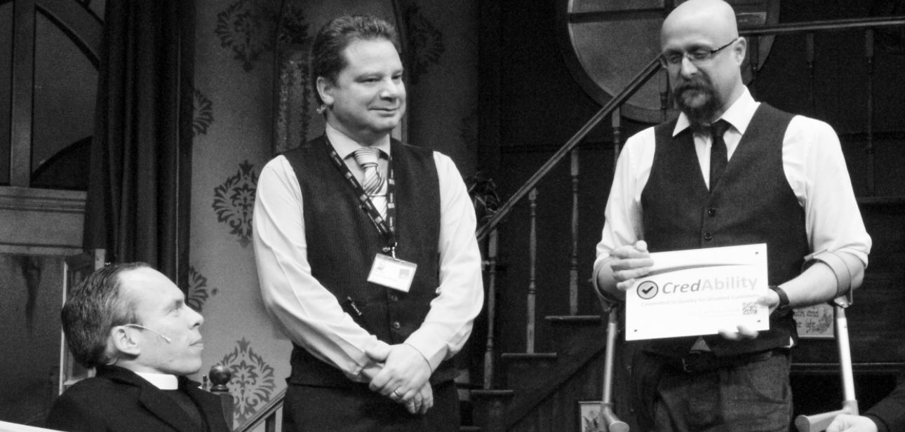 martin presenting an award with warwick davis to a credable provider