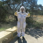 woman in full body beekeeper suit