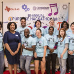 Volunteers from Microsoft, Swift Pace and other companies enjoy a red carpet welcome at the STEAM Achievers Fall Purpose Hackathon at University of Texas at Dallas