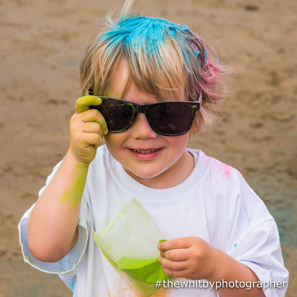 Child finished the Colour Run.