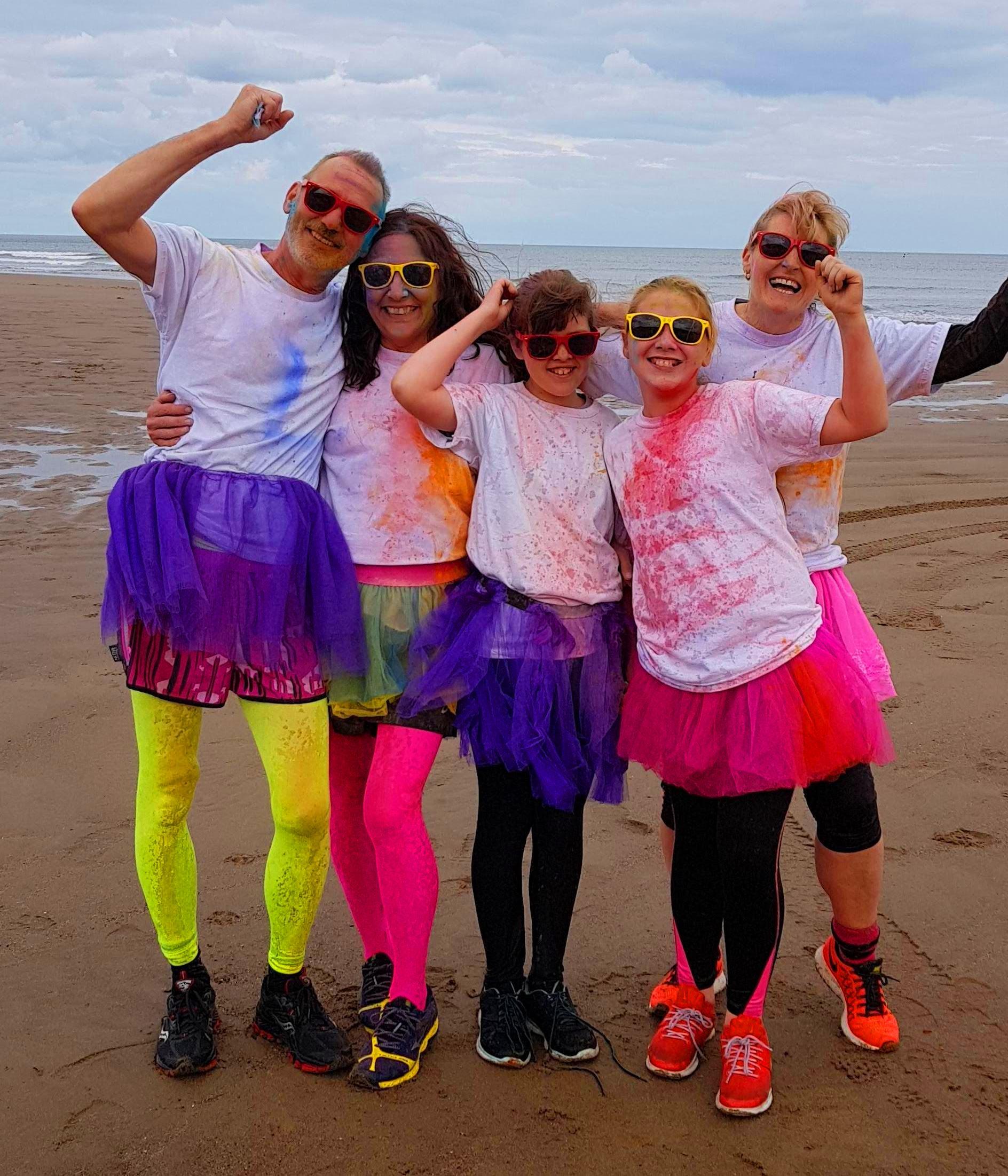 Family finish the colourful Colour Run.