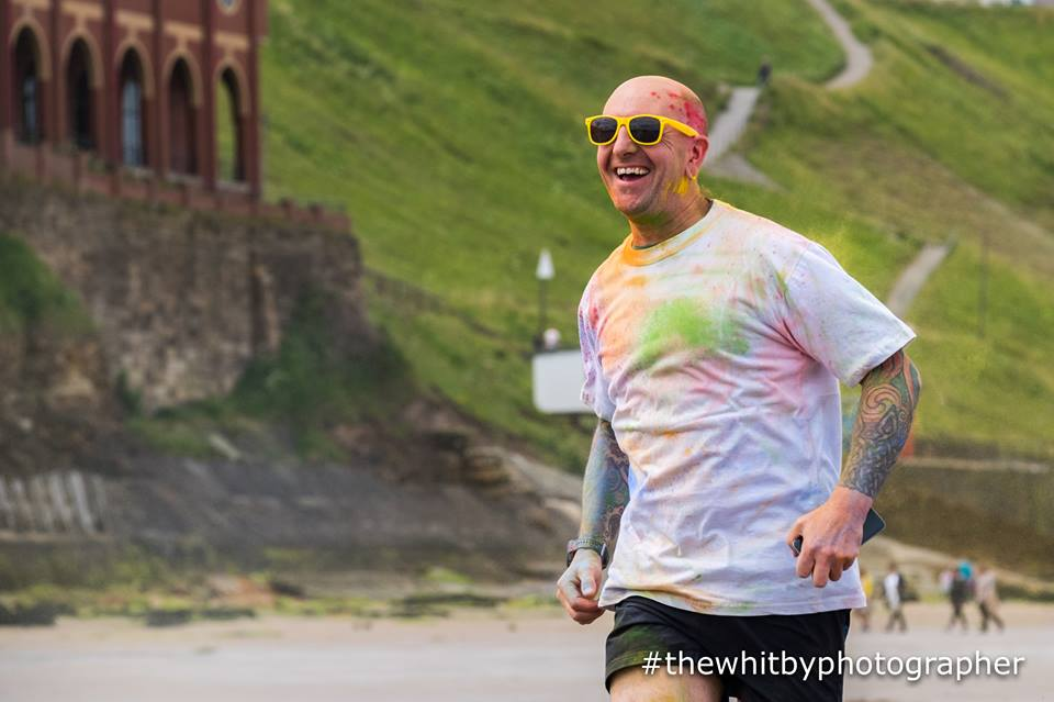 Colour runner running into the colour.