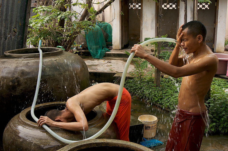 Morning bath at buddist monastery in Siem Reap, Cambodia