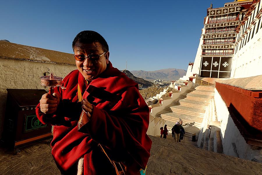 Buddist Monk in pilgrimage at Potala Palace, Lhasa, Tibet